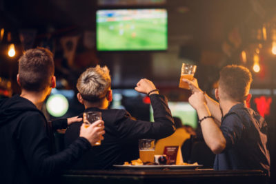 group celebrating at a club or pub with security monitoring cameras