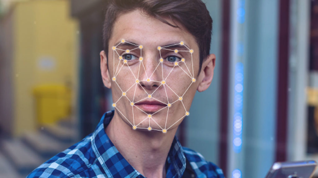 man with facial recognition software visual on face